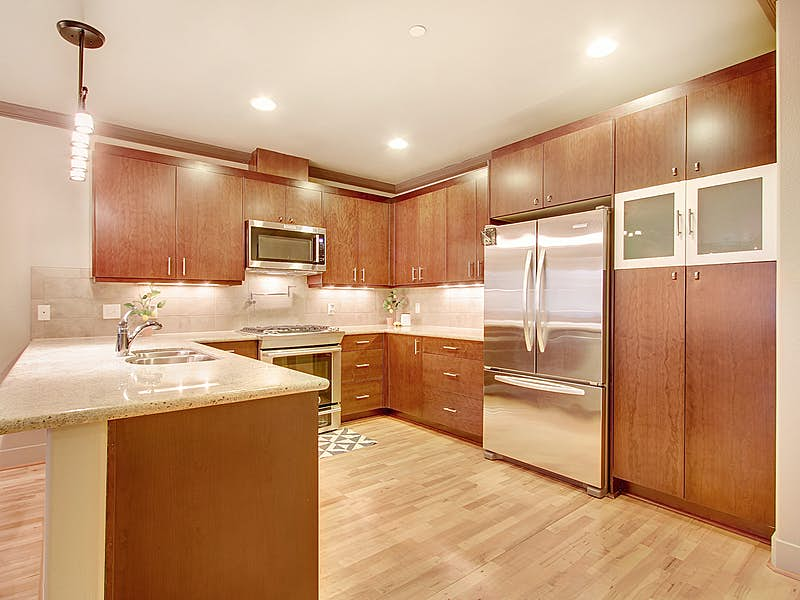 An exceptional kitchen with slab granite counters, generous cupboard space and gas range.