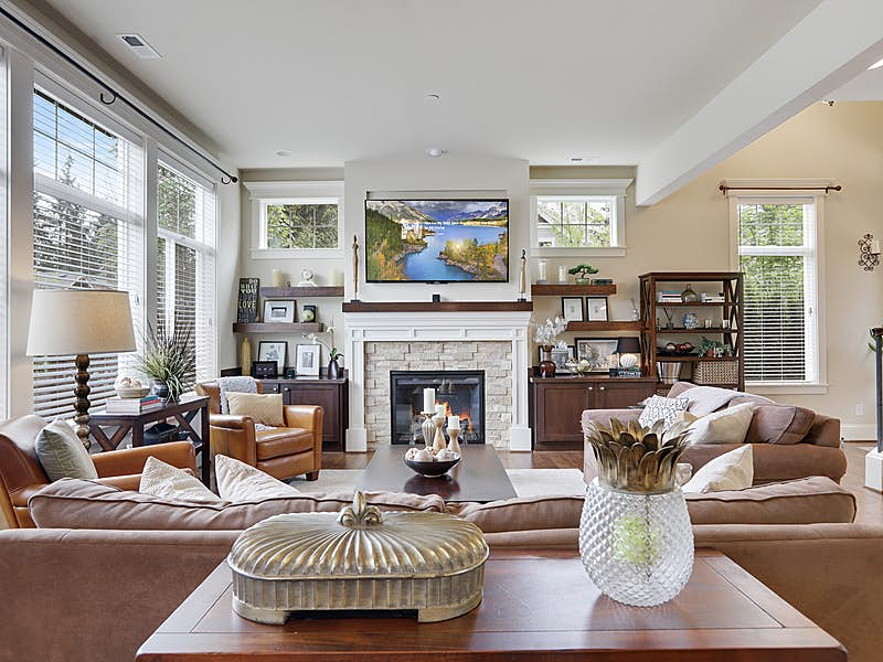 EXPANSIVE LIVING ROOM WILL ENTERTAIN FAMILY AND GUESTS