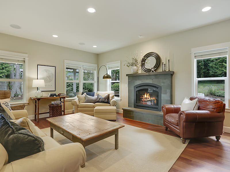 Great room adjacent to kitchen with cozy slate surround fireplace and in-ceiling sound system.