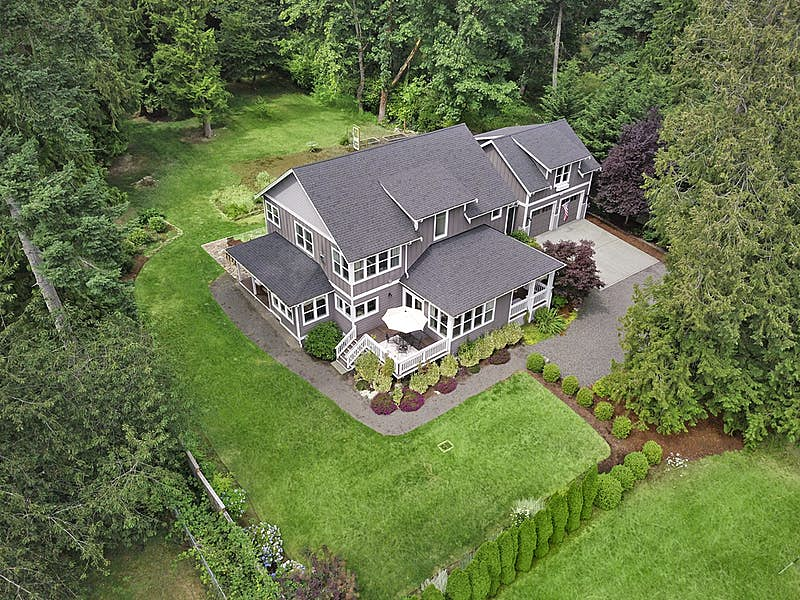 Charming 4 bed, 3.75 bath, 3677 sq ft custom craftsman on .91 professionally landscaped sunny acres.
