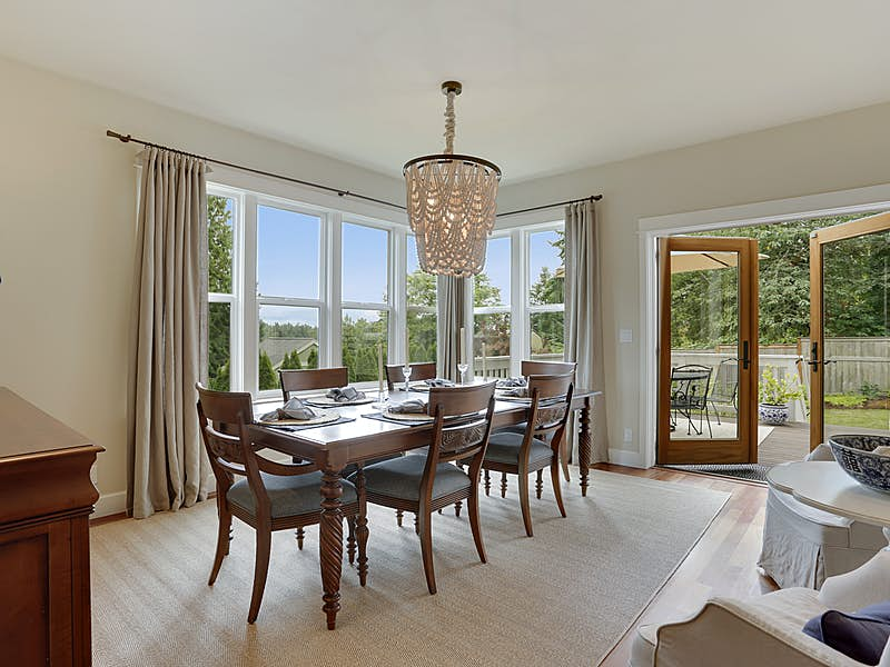 Dining room with expansive views and access to deck space through French Doors.