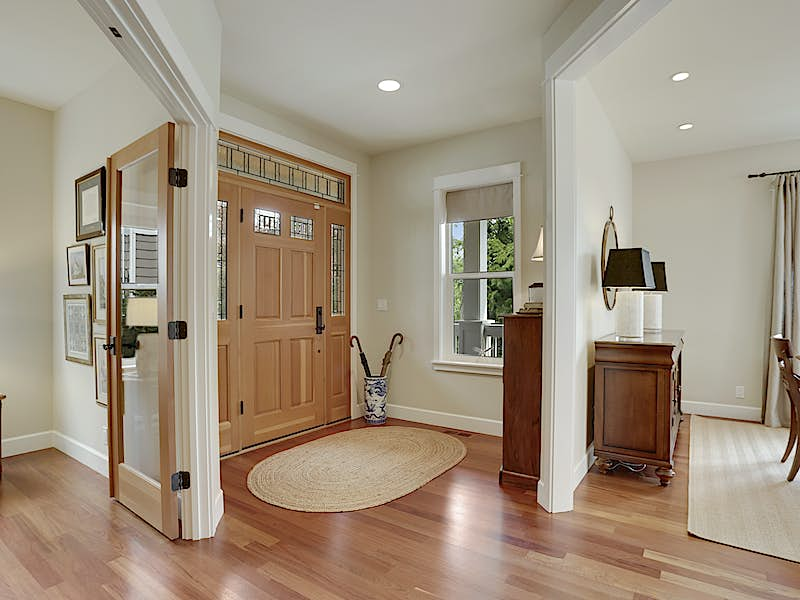 Gracious entry, custom Fir front door, and gleaming Cherry hardwoods.