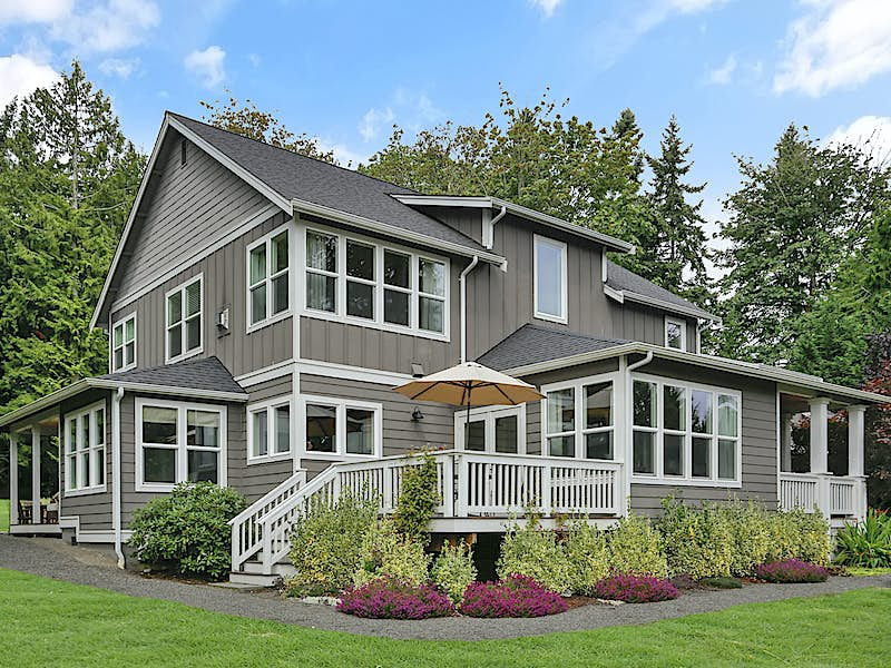 Covered and uncovered porches provide flexibility for day to day living and entertaining. Window package designed to capture and maximize light all year round.