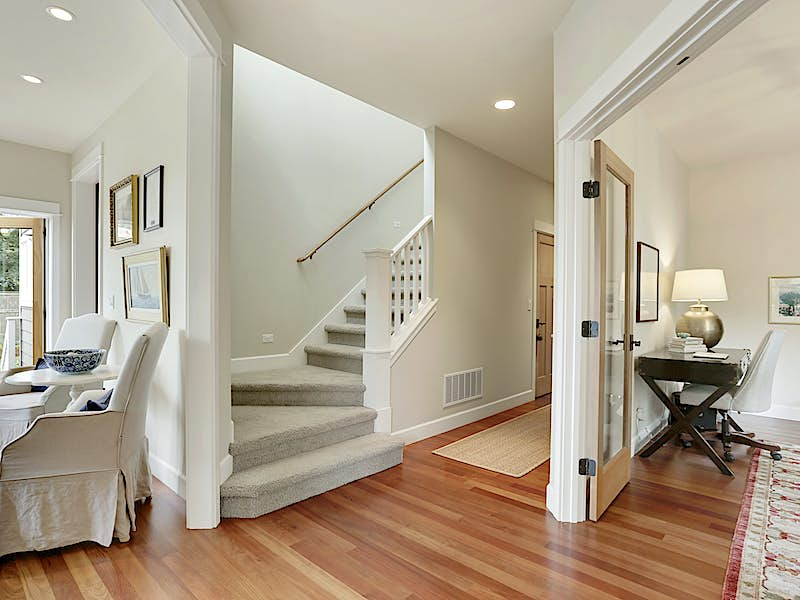 Primary stairway to upstairs bedrooms.