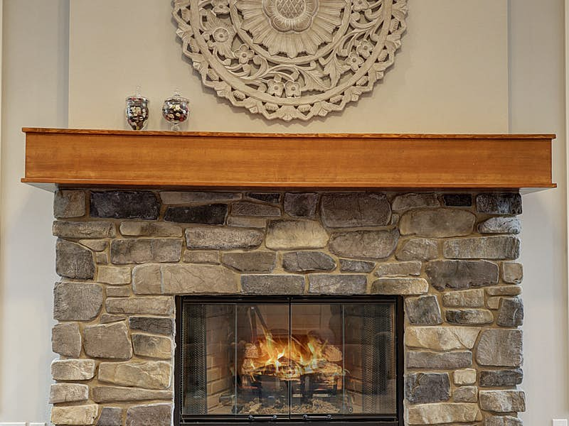 Detail of the craftsman rock front gas fireplace with custom shaker mantle