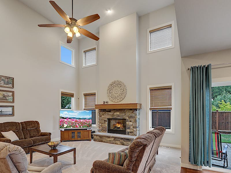 Family room features soaring 2-story ceiling & gorgeous rock gas fireplace. Complete with upgraded ceiling fan and custom window coverings