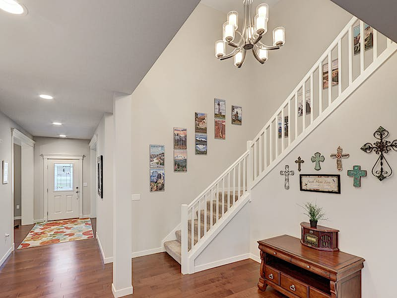 Gorgeous open stair rail to second floor. Open concept to family room, kitchen and front entry.