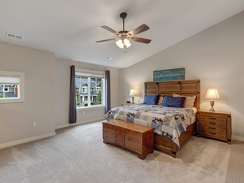 Dramatic vaulted master bedroom with upgraded ceiling fan