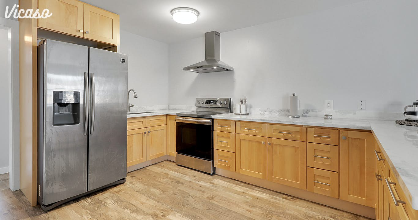 All new stainless steel appliances with ample storage.